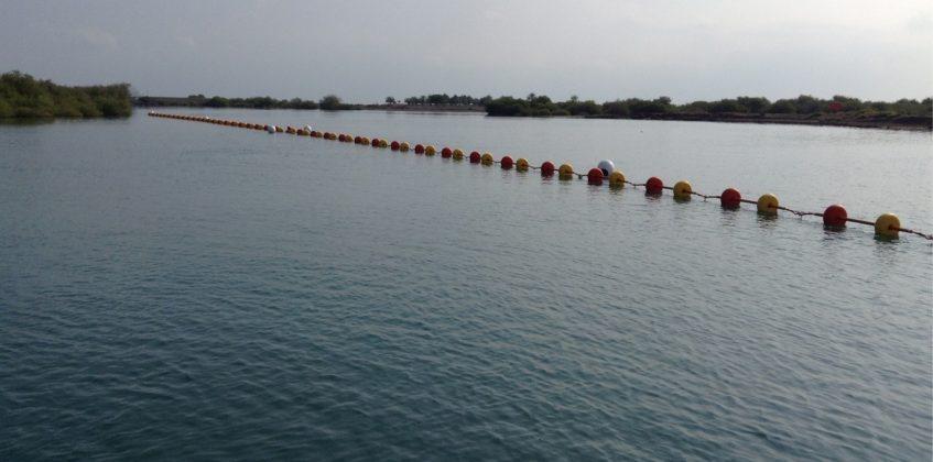 Floating barrier installation at Kalba